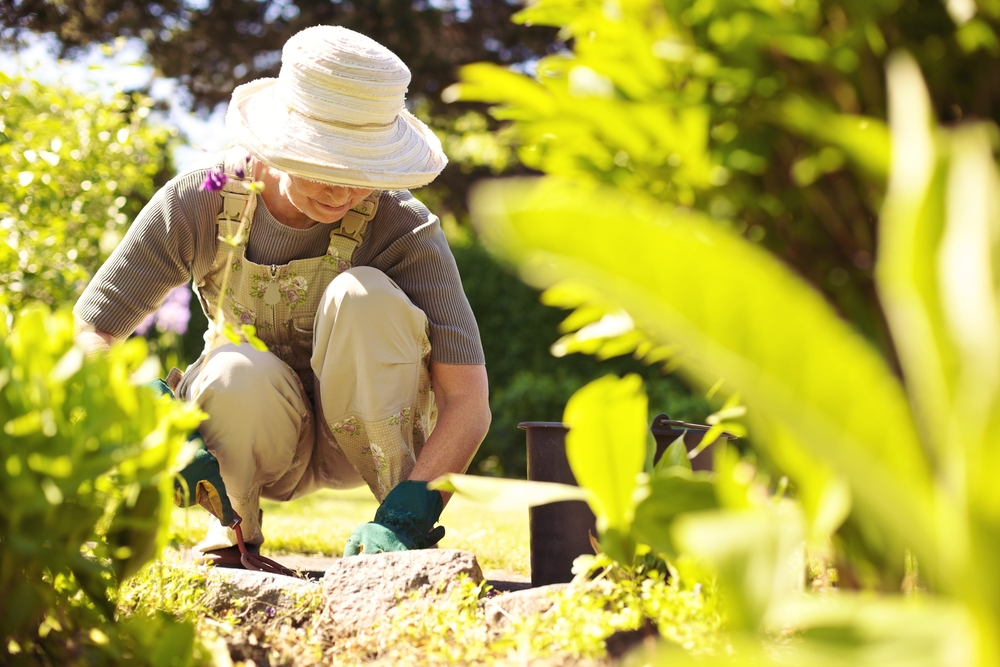 elderly lady gardening at barton park homes